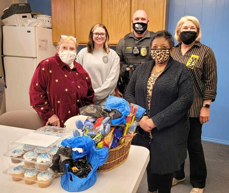 At the police department, from left, are Dianna Mueller, BSP member; Kaley Ludwig, police dispatcher; Chester Police Officer Joe Jany; Joyce McGee and Jeanne Wagner, both BSP members.