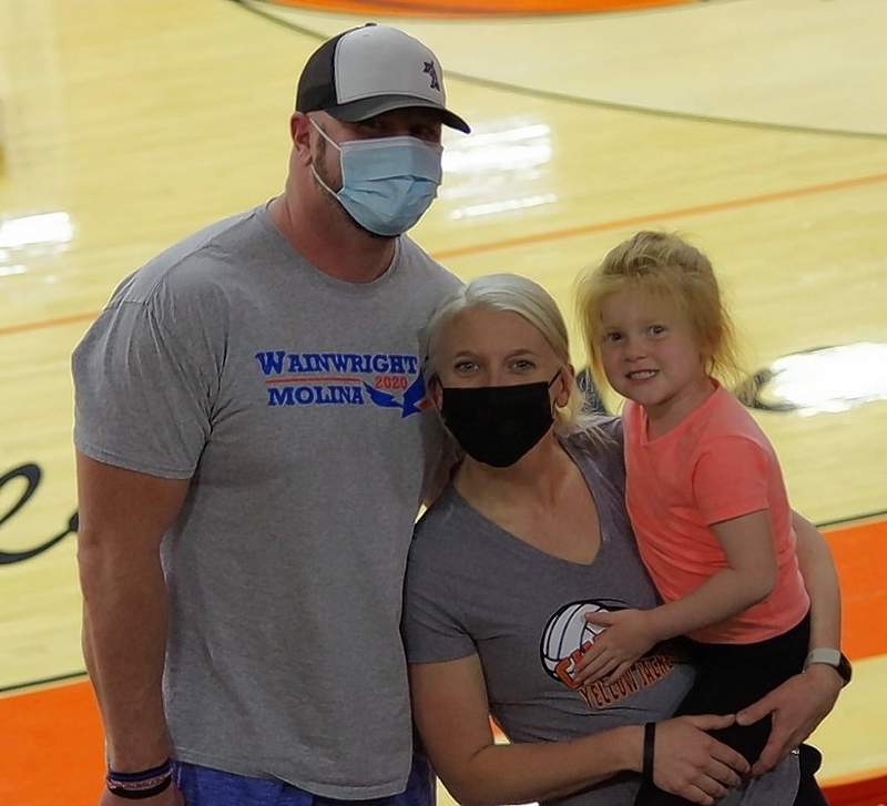 CHS head volleyball coach Colleen Runge with her husband Aaron and daughter Piper after the Lady Jackets beat the Valmeyer Pirates.