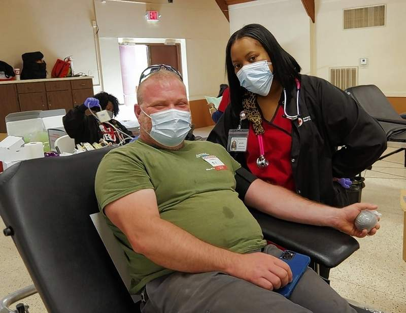 Business was brisk at the April 14 Chester blood drive, as Bill Johnson donates, assisted by Precious Ming of the Red Cross. Johnson has been a regular blood donor for about five years. The drive collected 43 usable units of blood. Next drives: May 5 at Chester High School and May 11 at the VFW.