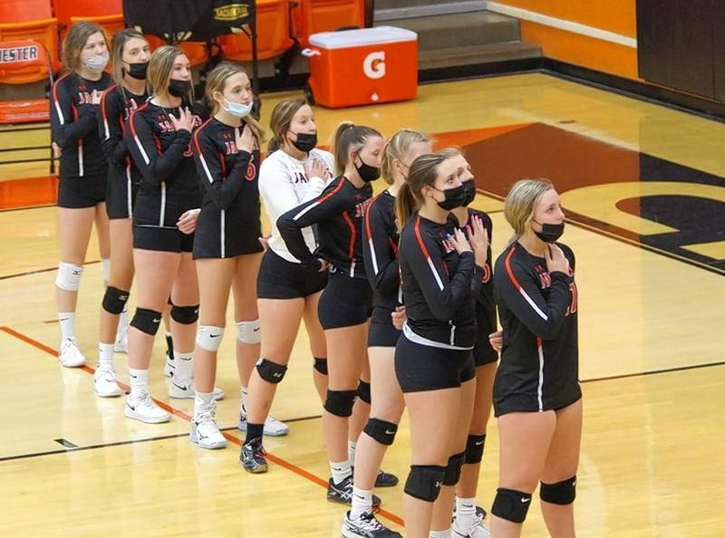 The varsity volleyball team stands for the national anthem prior to the match against Christopher on April 15. From left are Mabry Wingerter, Reese Chandler, Paige Vasquez, Jordan Buskhol, Peyton Clendenin, Kendall Williams, Katie Shinabargar, Josie Kattenbraker, Alyssa Seymour and Emma Eggemeyer. Not pictured, Lauren Soellner.