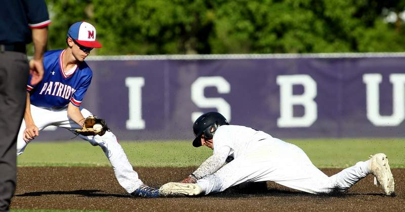 Harrisburg's Javie Beal slides safely into second base during Friday's IHSA Class 2A Regional semifinal matchup against Massac County at Jay Thompson Field in Harrisburg.
