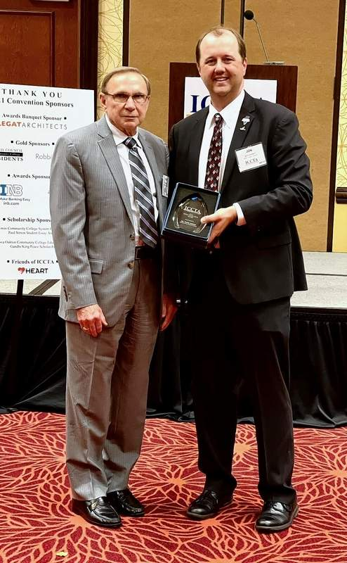 Southeastern Illinois College Vice Chair of the Board of Trustees, Dr. Frank Barbre, left, is the first recipient of the Illinois Community College Trustees Association President's Award by President Jon Looney. The award celebrates an unsung hero who has supported ICCTA and community colleges.