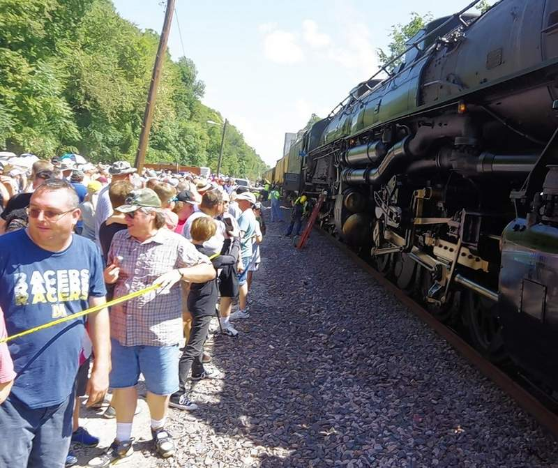 Crew members step off the train as it comes to a stop in Chester.