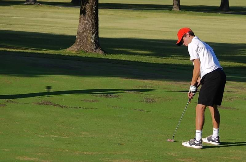 Chance Mott, a CHS junior, putts on the green at the Chester Country Club.