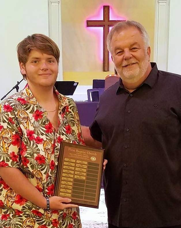 Ridge T. Fogerson, left, receives the 2021 Edna Sharp scholarship from Don Berry, deacon at first Baptist Church in Chester.
