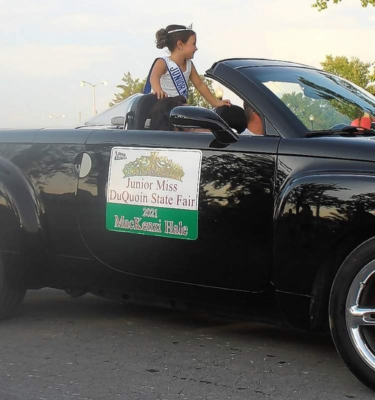 MacKenzi Hale, the DuQuoin State Fair Miss Junior Miss, rides in the Twilight Parade.