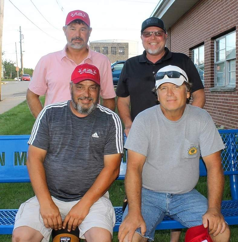 The B Flight winners are, front row from left: Chris Downen and Will House. Back row from left: Rich Keller and Bucky Thies.