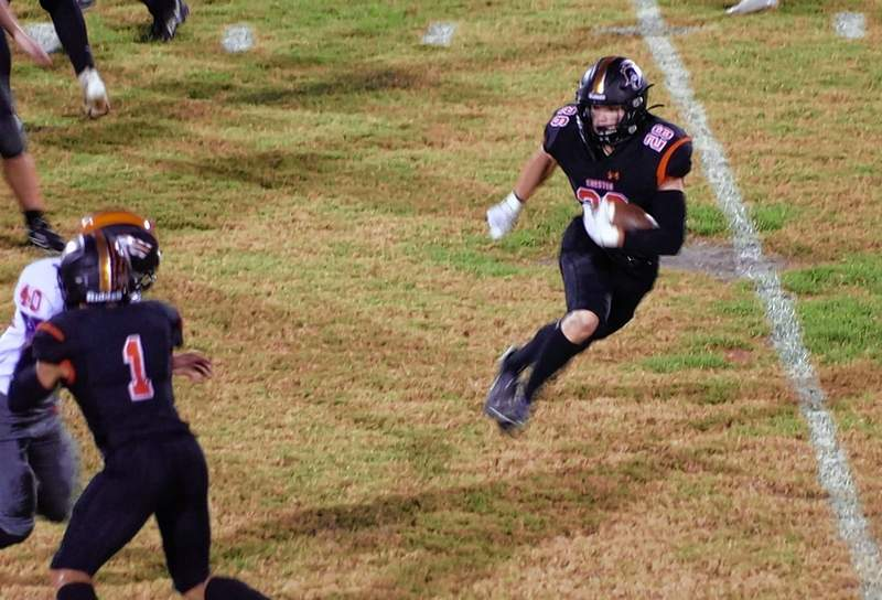 Chester's Aiden Jany makes a cut on a great run to gain 13 yards and a first down.