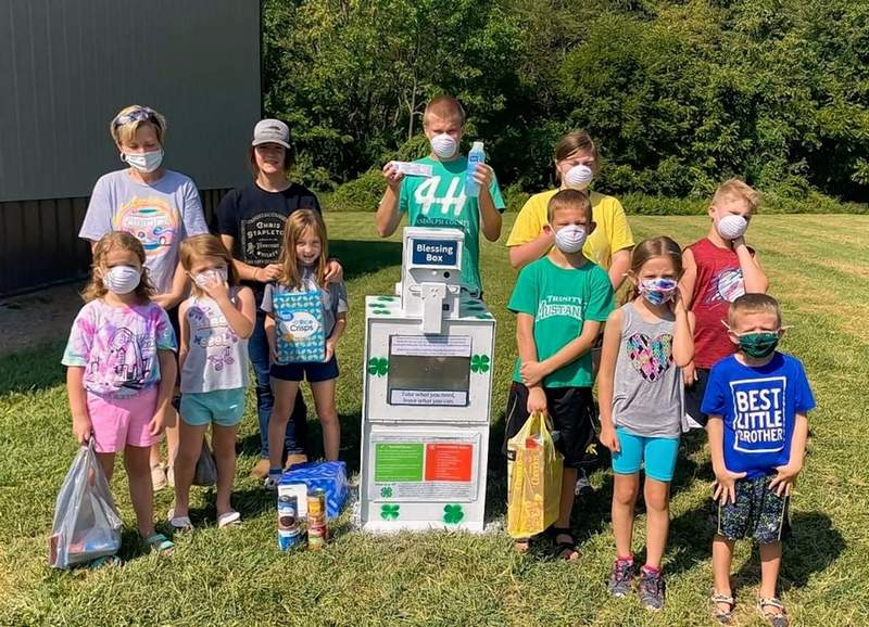 Local youths decorate and stock a blessing box at a recent 4-H workshop. Back row, from left, are 4-H volunteer Charlene Stewart, Breanna Autry, David Koester, Kinley Lauer and Breckon Lauer. Front row, from left, are Finley Demond, Addalyn Lauer, Annabelle Pearce, Micah Sattler, Leah Sattler and Elijah Sattler.