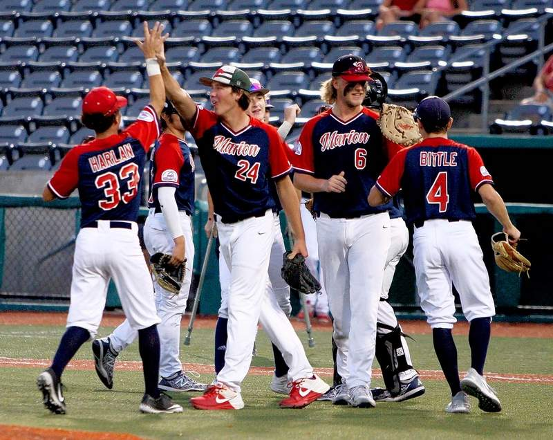 Members of the Marion Colt Team celebrate their victory over Brownsville, Texas, in the championship of the Colt World Series at Rent One Park this summer.