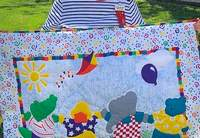 Mary Ann Stumpe of Chester displays the colorful quilt she handquilted and donated to the Beta Delta chapter fundraiser.