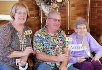Chris and Patty Jeffreys join Mary Ann, far right, at her birthday party Oct. 10 at the Chester United Methodist Church.