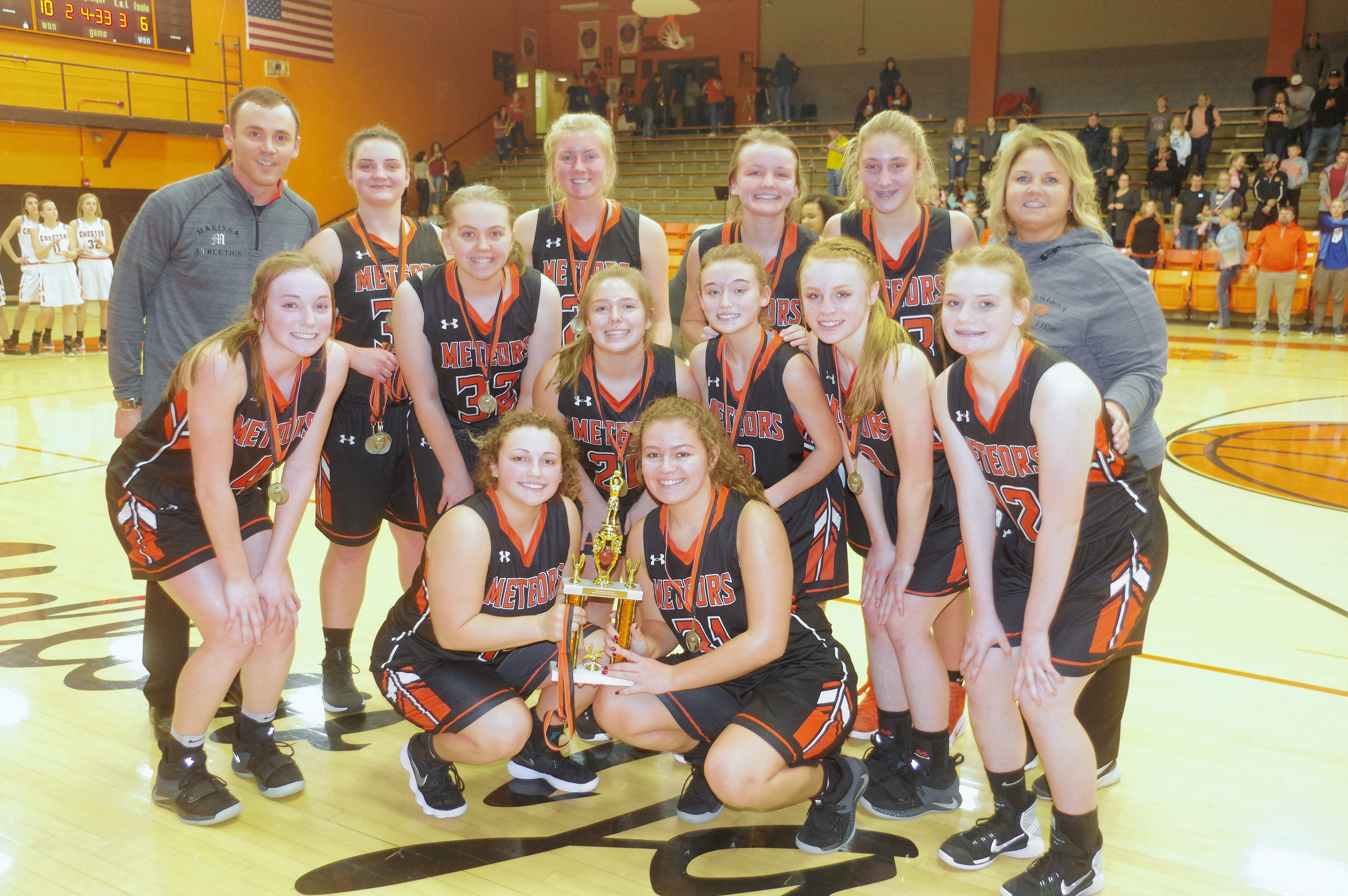 The Marissa-Coulterville Lady Meteors with their championship trophy. members of the team are Emma Walker, Emily Smith, Bree Portz, Kyleigh Landi, Casey Daugherty, Grace Zimmer, Grace Middendorf, Olivia Quigley, Taylor Wyninegar, Hailey Krause, Macey Schreiber, and Destiny Griffith.The Lady Meteors are coached by Darin Degenhart and Laura Kohrs-Robinson.
