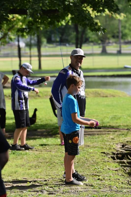 An East Side student tries his hand at fishing.